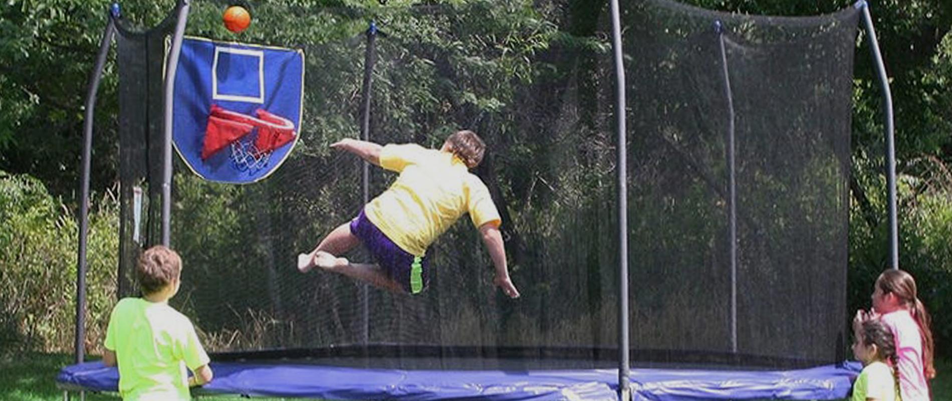 trampoline with basketball hoop